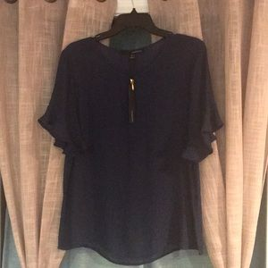 NWOT Navy blouse with gold accent zipper